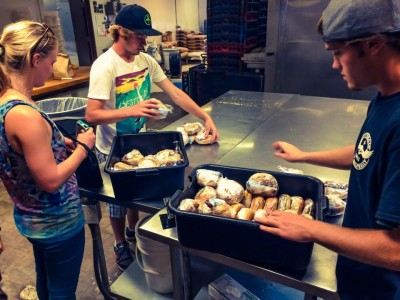 The Van With No Plan (Josh and Matt Monthei) and Sydney making sandwiches for those in need.